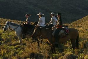 Ride through barren rolling hills...