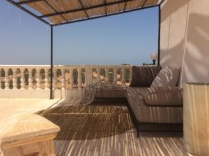 Lounge at top of the house with ocean view